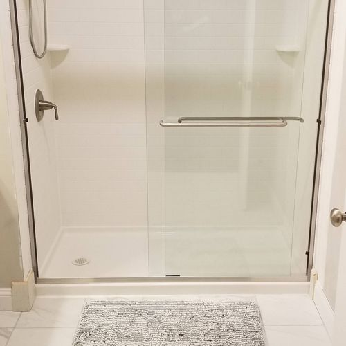 Swan stone shower unit, wall surrounds,  glass door unit  and surrounding trim finishes