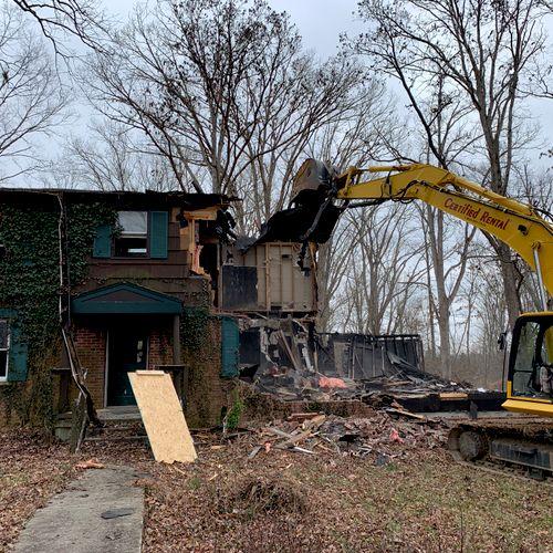 Fire damaged house demolition