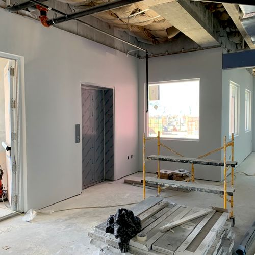 Level 4 finish plus primer and painting on around 100 sheets of drywall Approximately $6,000 All materials included