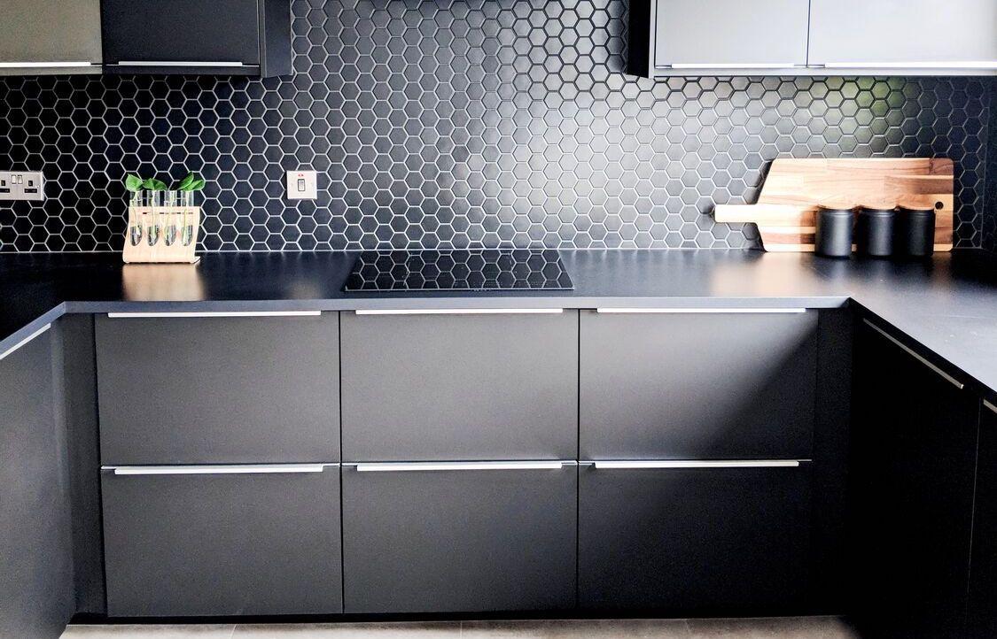 black kitchen cabinets and backsplash