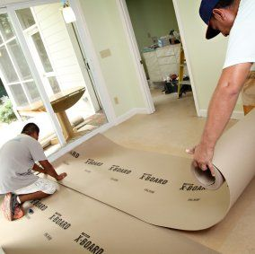 Rolling out floor protection on hardwood