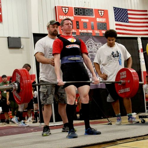 Me performing a 501 pound deadlift in a powerlifting competition, accomplishing my goal.  Let me help you reach your goals as well!