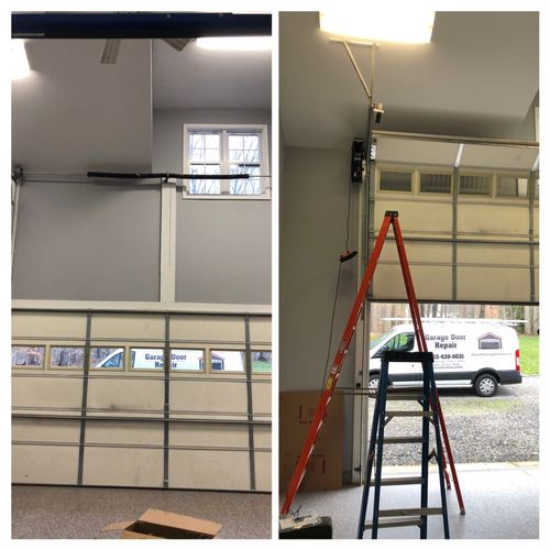Installed hi-lift track and side mount opener to accommodate car lift