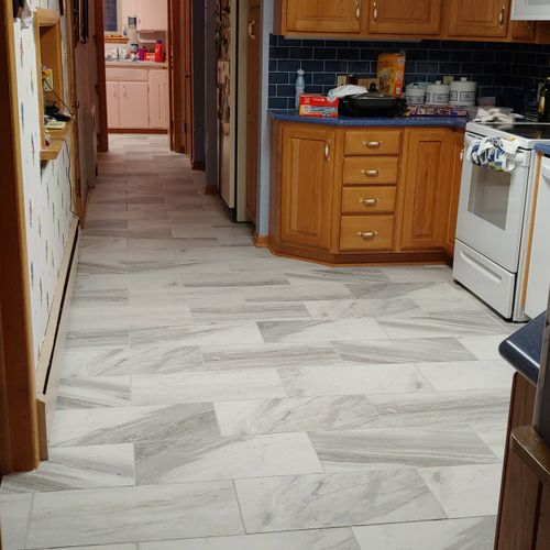 """12""""x24"""" porcelain tile in kitchen, hallway, and laundry room"""