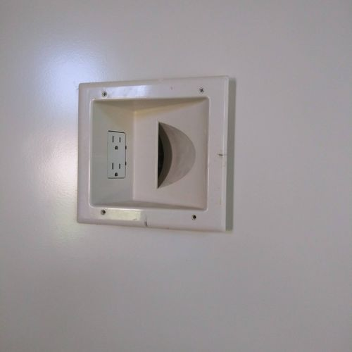 power outlets raised with pass through box for behind TV.