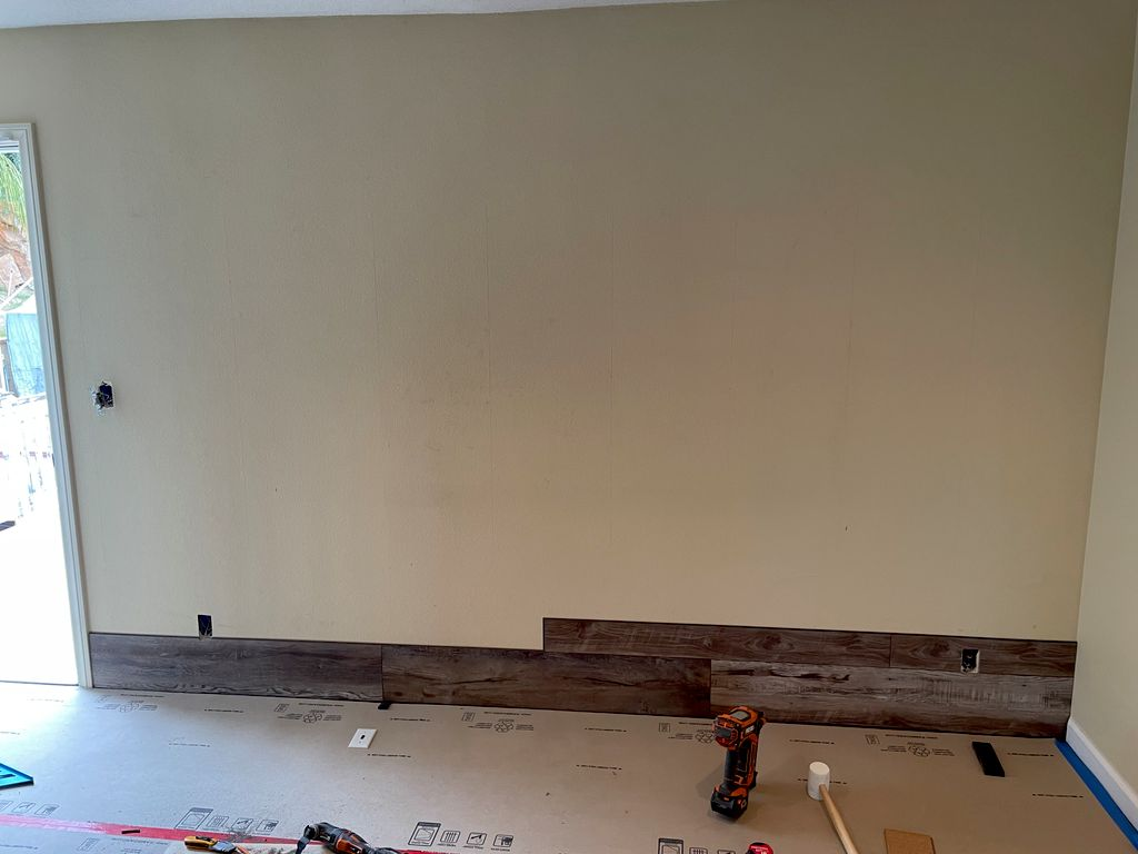 Wall renovation with laminate flooring
