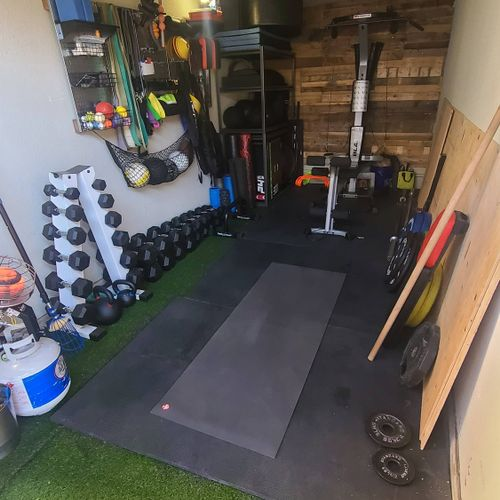 fully equipped garage gym space.