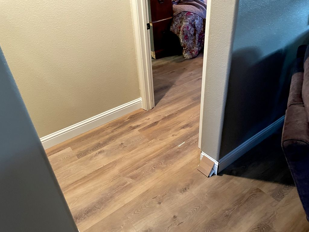 Replacing old laminate flooring with 9 inch wide vinyl plank
