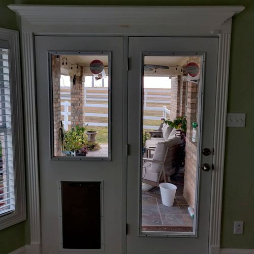 installation of a french door with a doggie door pre-installed