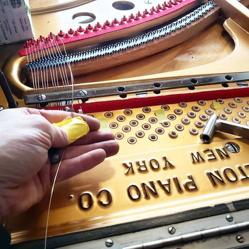 Re-stringing an upright piano