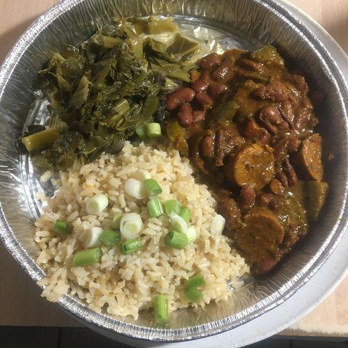 Cajun  vegan red rice, with veg sausage and organic rice and southern greens