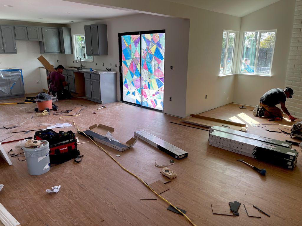 Installing new Vinyl Flooring for B-Line Construction