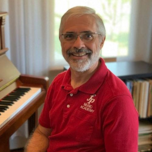 Mike - President and Piano Teacher