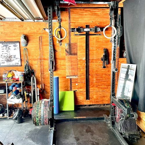 Squat Rack, Cable System, Gymnastic Rings, Barbell and Plates, Balance Pad, Kettlebells, Dumbbells 10-90lbs