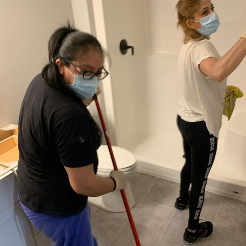 sweep and mop all bathrooms