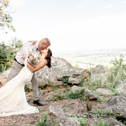 A bride and groom share a kiss during their mountainside elopement at Sugarloaf Mountain in Urbana, Maryland.