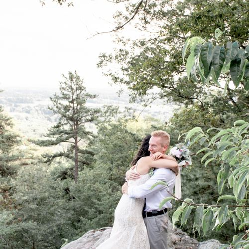 A bride and groom hug one another at their mountainside elopement at Sugarloaf Mountain in Urbana, Maryland.