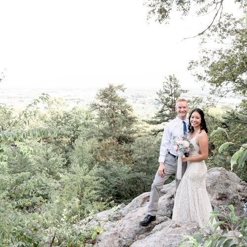 A bride and groom pose for a portrait at their mountainside elopement at Sugarloaf Mountain in Urbana, Maryland.