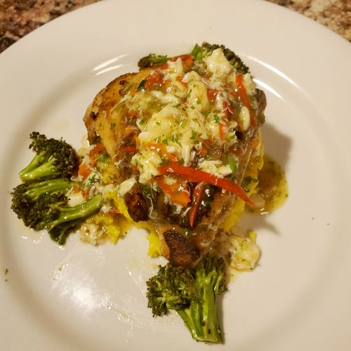 blackened Catfish with lump crabmeat saffron sticky rice roasted broccoli.