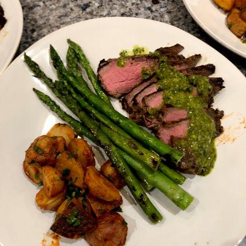Grilled flank steak with chimichurri, patatas bravas, grilled asparagus