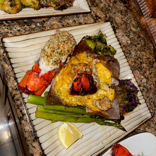 Lobster tails, seafood Mac, Brussel sprouts, cabbage and asparagus