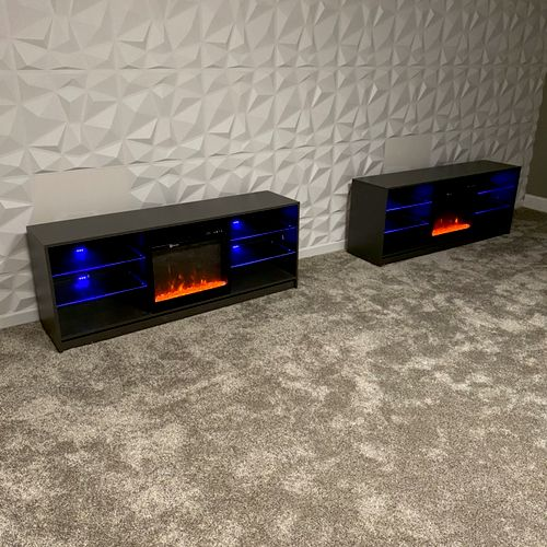 Dual TV stand/fireplace consoles assembled