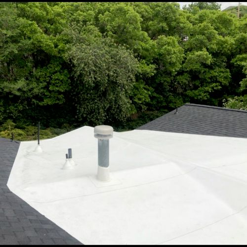 Bountiful roof with shingles and TPO membrane.
