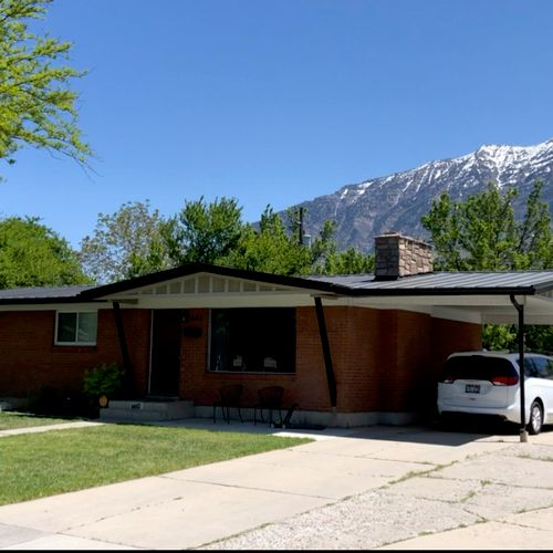 Orem roof replacement with standing seam metal. New soffit, facia and rain gutters.