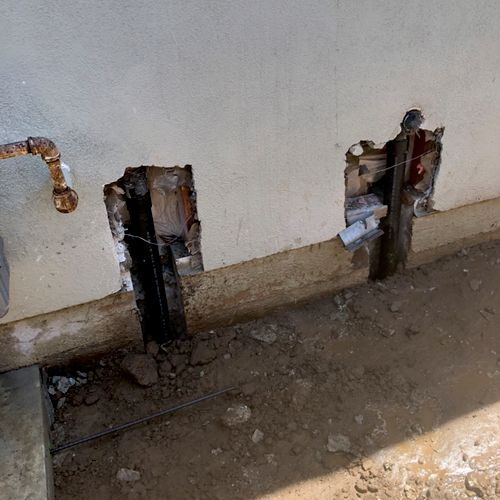 Double kitchen sink reroute. Rerouted the kitchen drain line around the home to the main sewer to minimize damage inside the kitchen.