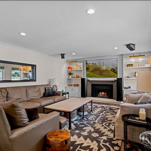 Remodeled family room with built in shelves and shiplap fireplace