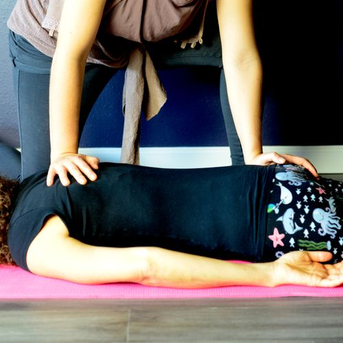Floor shiatsu. Shiatsu is a clothed modality and can be practiced on the floor.