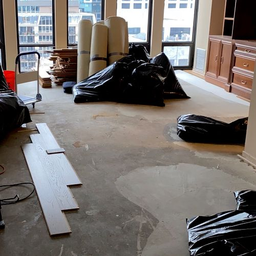 Flooring removed and disposed