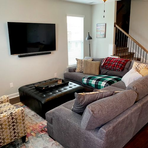 Swivel mount with 7 point surround sound, sound bar, Apple TV, Directv and Home Surveillance system. All cables hidden per home owners request.
