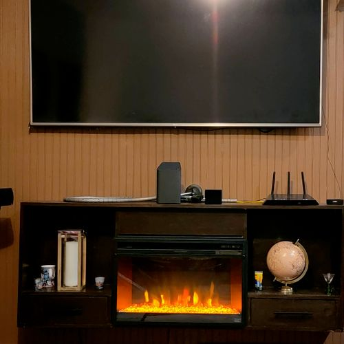 Floating entertainment center/fireplace