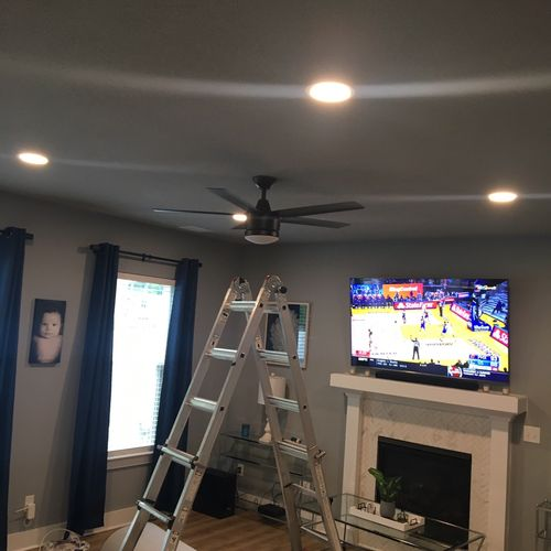 Recessed lighting and ceiling fan installation.