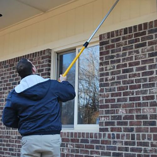 Outdoor pest control includes sweeping for spiders and spraying for flying pests.