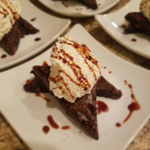 Moroccan Chocolate Brownie with Cardamom Whipped Cream and Pomegranate Molasses Drizzle