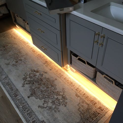 Under cabinet lighting installation.