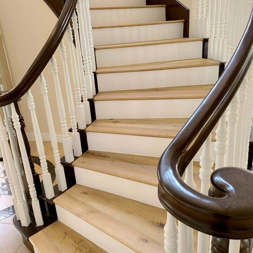 curved staircase with white risers