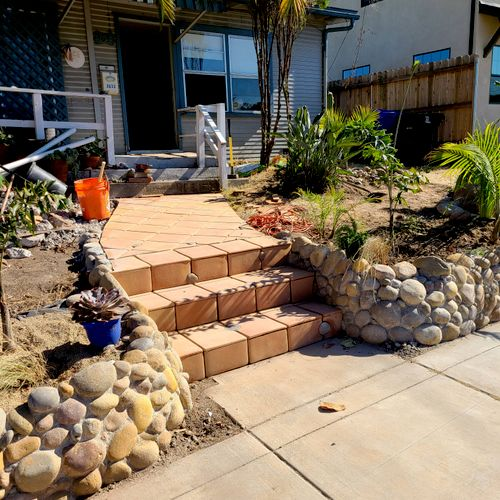 Natural stone retaining wall with terracotta tile steps