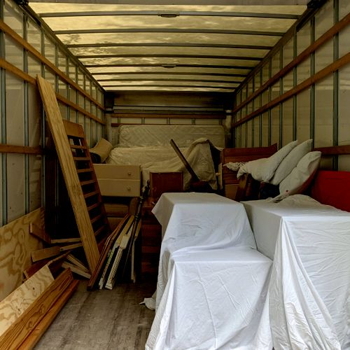 Safely organized furniture inside of a 26ft truck from a recent moving job!