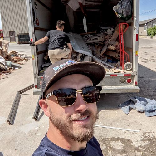 Andrew, Derek and Josh unloading mixed junk at the dump from a recent demolition we cleaned up!