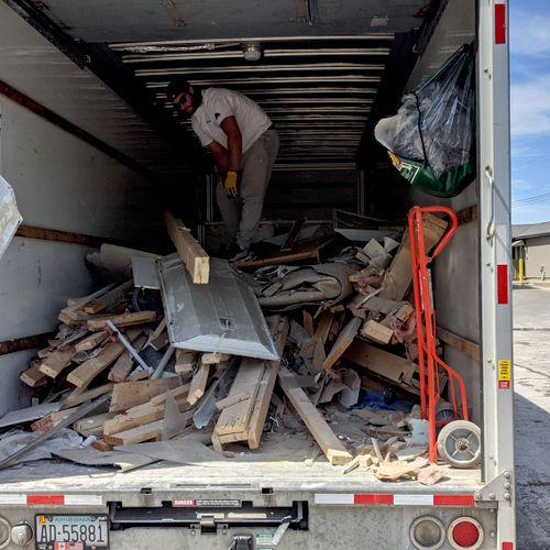 Josh and Derek working hard unloading 4,000lbs of mixed scrap!