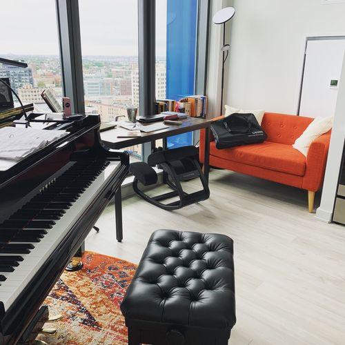Home studio teaching with a Yamaha GC1 grand piano.