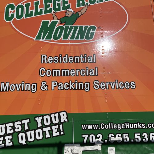 College HUNKS Moving Truck on the Road