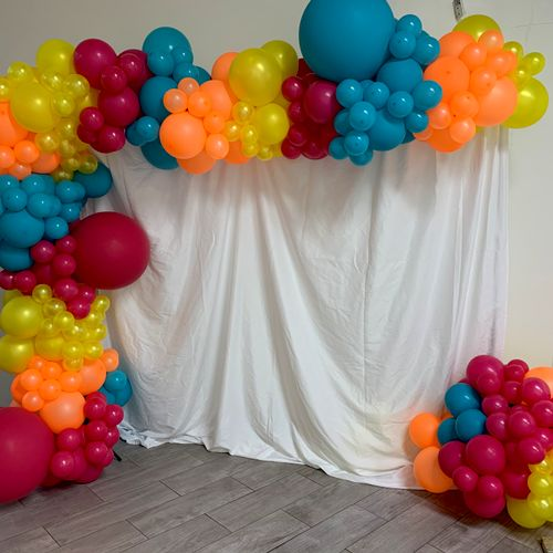 Colorful balloon garland and backdrop by @balloons_by_a