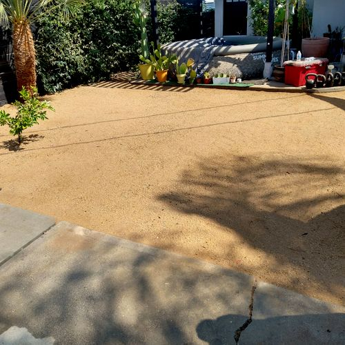 removal of weeds and adding d.g. to backyard.