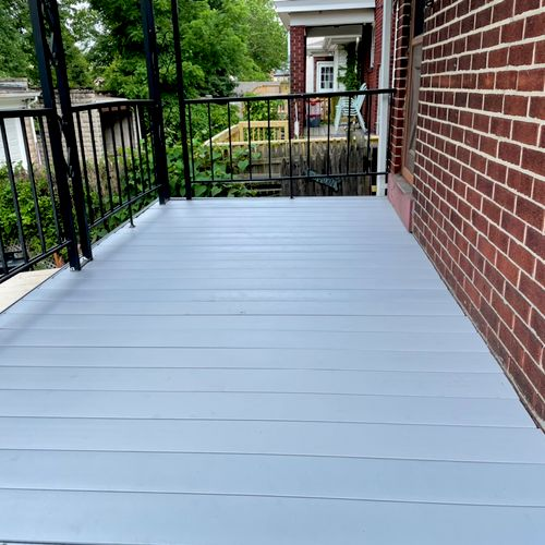 Composite decking boards installed with no show fasteners for a clean look