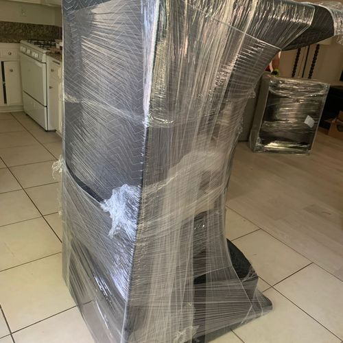Local movers - best rates - wrapping furniture