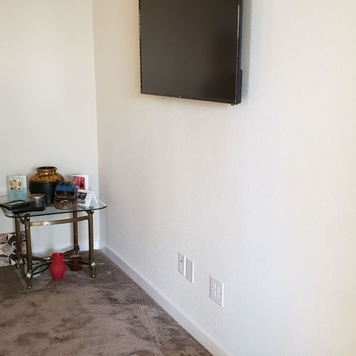 TV mount with new plug installation for wire concealment.